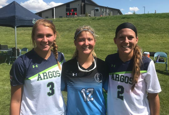 Gillette College's Kelsey Hogan (12) is flanked by former C.M. Russell teammates Kaelyn Frahm (3) and Eme McLaughlin (2) following the Gillette-Providence soccer scrimmage Thursday at Argo Field.