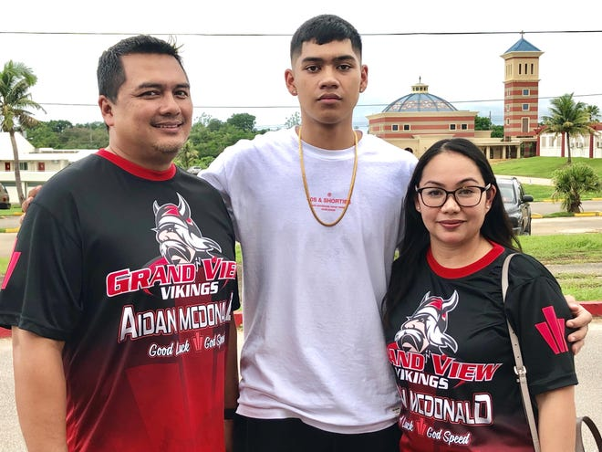 "Aidan ""Moonwalker"" McDonald, center, signed a letter of intent to play collegiate volleyball at Grand View University in Iowa. He is shown with his parents Eugene McDonald and Nikole Benavente, at a signing ceremony held Aug. 14 at the Father Duenas Memorial School Phoenix Center."