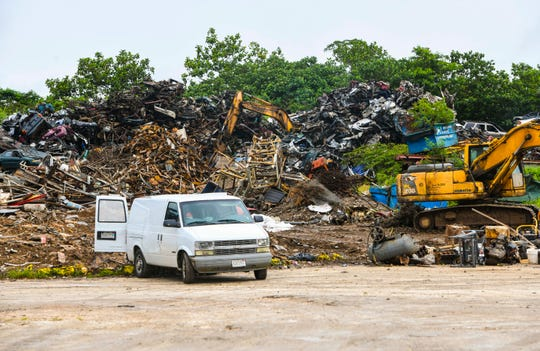 Heavy machinery is used to sort through various scrap metal pieces within the compound of the Global Recycling Center, along Bartolu Street in Dededo, on Thursday, Aug. 15, 2019.