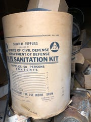 A fiberboard drum contained a Civil Defense SK IV sanitation kit with a variety of personal sanitary supplies including toilet paper and a commode seat. Lined with a polyethylene bag, the drum was intended to be used as a fallout shelter toilet.