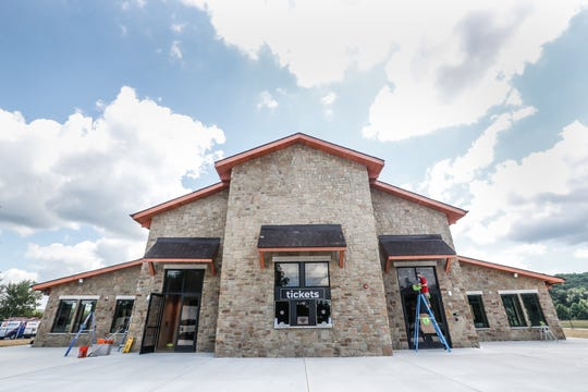 Staff and contractors put finishing touches on the Brown County Music Center, just hours before the soft opening of the new venue in Nashville Ind., on Thursday, Aug. 15, 2019. The venue can seat about two thousand.