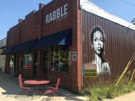Jules Muck painted a mural of singer Nina Simone at Rabble Coffee, 2119 E 10th St.