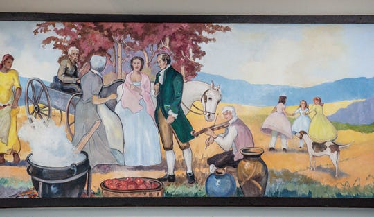 Murals painted by Indiana artist George Lachance were   donated to the Brown County Music Center by the family of prominent businessman Andy Rogers, who once owned The Nashville House, in Nashville Ind., on Thursday, Aug. 15, 2019. The painting includes three of the Rogers children, far right.