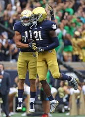 safeties Jalen Elliott (21) and Alohi Gilman (11) both were named Notre Dame captains for the 2019 season.