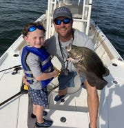 Pictured with his son Fisher Daniels, 6, Ronnie Daniels of Fisher-Man Guide Service said conditions are coming together for excellent fall fishing on the Mississippi coast.