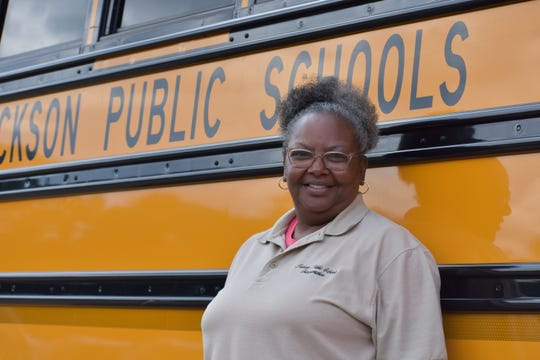 "Sandra Jenkins, 59, has been a bus driver for 23 years in the Jackson Public School District. ""I greet them and I want them to feel safe knowing that Ms. Jenkins is going to get them to school safely."""