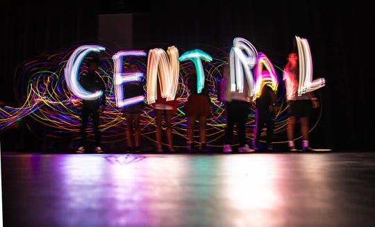 Students practice slower shutter speed to write letters using light in enhanced Digital Arts and Graphic Design class at Central High School on Aug. 14.