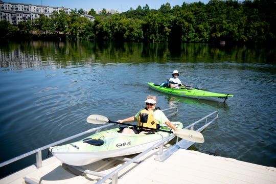 Cheryl Harrell, of Knoxville, and her friend Lynn dock at the new EZ Launch at Suttree Landing Park in South Knoxville, Tennessee on Thursday, August 15, 2019. The $2 million project includes the first city-owned ADA-accessible kayak launch system. The dock will be for non-motorized watercraft only and will be open year-round.