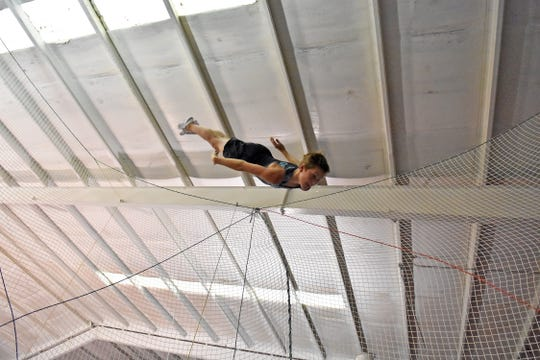 West Valley Middle School student Brooks Barber flies high above the trampoline at Tataru's Gymnastics and Tumbling facility during practice on Wednesday, August 14, 2019.