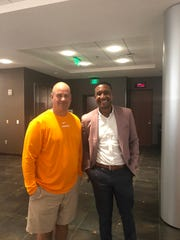 Tennessee football coach Jeremy Pruitt and financial adviser Didier Occident after Occident spoke to the Vols on Aug. 10, 2019.
