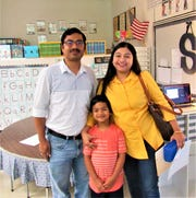 """Parents Satya and Poulomi Sen brought son Aayush to """"Meet the Teacher"""" day at Farragut Primary School on Aug. 2. 2019"""