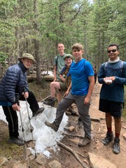 Elijah Wynn, Caleb Nobles, Joey Genna, Cameron Smith and Travis Tyimok all said they were amazed when they came across snow and ice while hiking at Philmont Scout Ranch in Cimarron, N.M., in June.