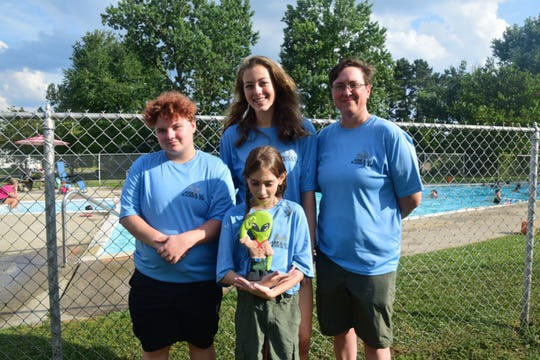"""Our mascot is an alien. It's a play on Area 51 because we're Troop 51. He goes everywhere with us,"" said Jadzia Garner, 10 (front), with Evan Damiano, 17; Holly Van Dyke, 15; and Troop 51 Scoutmaster Jennifer Garner at a combination Court of Honor and pool party held at Northampton Pool Saturday, Aug. 10."