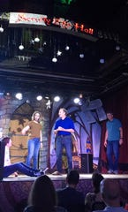 The stage of Scruffy City Hall is the home every Thursday night of Einstein Simplified and the packed crowd that the troupe attracts. Shown here are Aaron Littleton as Honey Boo-Boo, Stefanie Benjamin as Frankie Muniz, Paul Simmons as a club bouncer, and Greg Huff as Screech.  August 13, 2019.