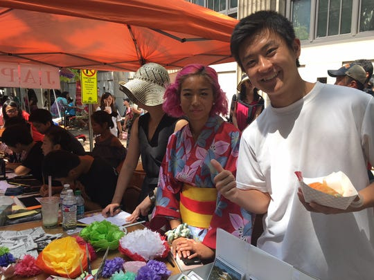 Here are Airi Tagchi and Sato Nelson at the East Tennessee Japanese School booth, 2018 Knox Asian Festival. Food, crafts, costumes and representative showings from more than a dozen Asian countries make it one of Knoxville's most colorful and popular events.