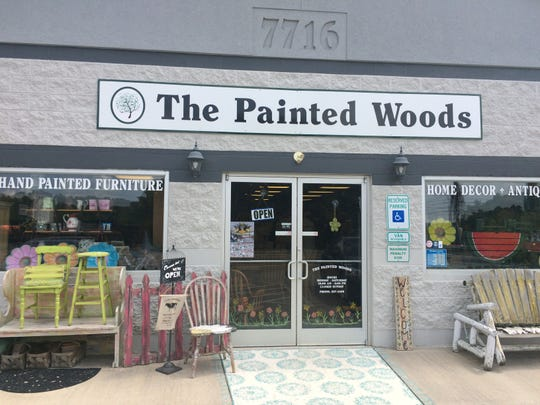 The exterior of The Painted Woods has an Eve Kiser-inspired theme that includes a painted rug in front of the door.