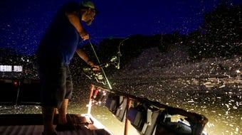Gene Mills bow fishes for Asian carp on the Tippecanoe River.