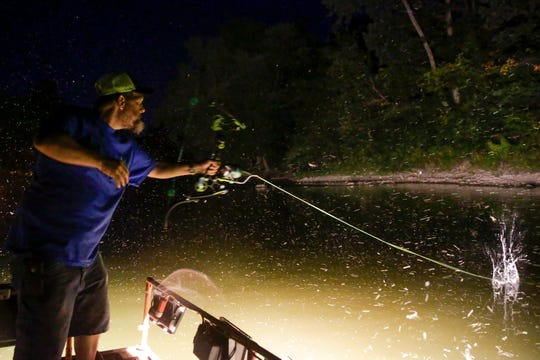 Gene Mills shoots his line into the Tippecanoe river will fishing for Asian carp, Wednesday, Aug. 14, 2019.