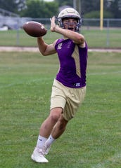 Senior Kyle Lutz is one of three players vying to become Fowlerville's starting quarterback.