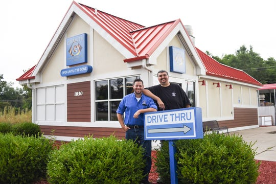 Bruce Kring and James Stine of Gravity Smokehouse & BBQ in front of their new brick and mortar on S. Cedar Street in Holt opening Aug. 21st.  The two have been friends since they were 13-years-old.