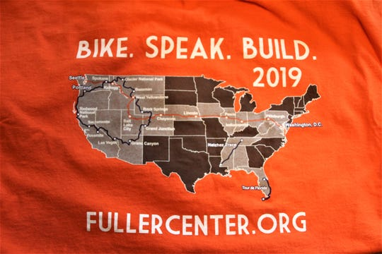 The back side of the t-shirt commemorating this year's Fuller Center rides shows the trails cyclists followed. The orange line from Seattle to Washington, D.C. is the path Sheridan and his teammates followed.