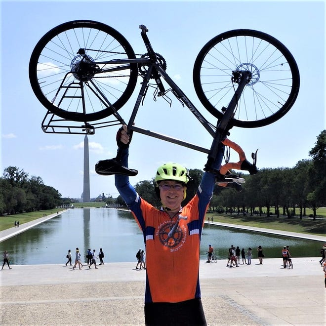 Marion resident Dan Sheridan celebrates completion of his cross-country bicycle adventure on the steps of the Lincoln Memorial in Washington, D.C. Sheridan raised $7,820.70 to support the Fuller Center for Housing, a non-profit organization dedicated to eliminating poverty housing worldwide.