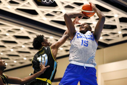 Memphis Tigers forward Lance Thomas shoots the ball over Bahamas Select's Basden Ziv during their exhibition game at the Grand Hyatt Baha Mar's New Providence Ballroom on Thursday, August 15, 2019.