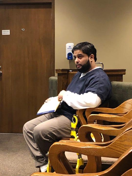 Anwar Ghazali listens during the closing remarks of his murder trial.
