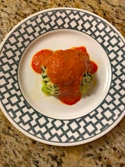 Fiorella's Italian Tomato Sauce, shown her over zucchini noodles, couldn't be much simpler.