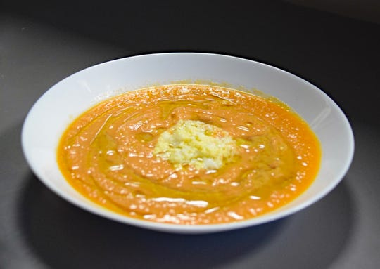 Olive oil in chef Gregory Leon's salmorejo turns the cold tomato soup a rich shade of orange.