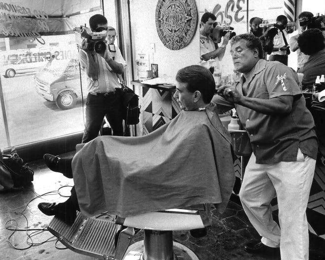 Joseph Amado Ortiz cuts Tommy Thompson's hair in 1986 at  Jose's Master Barber shop, 760 N. Jackson St.