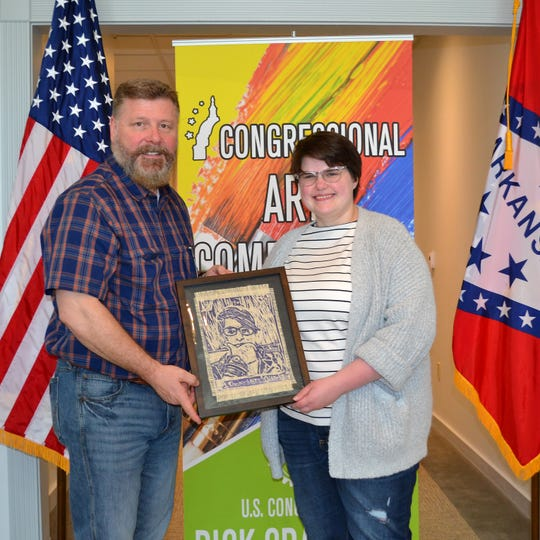 Congressman Rick Crawford (left) congratulates Elise Kerns of Mountain Home High School on winning thethe print category for the first congressional district's 2019 Congressional Art Competition.