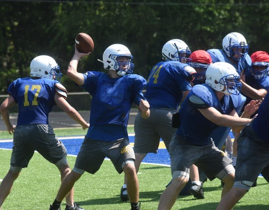 Mountain Home quarterback Lawson Stockton passes during practice earlier this week. The Bombers will practice around 8:15 p.m. Friday to finish Bomberfest.