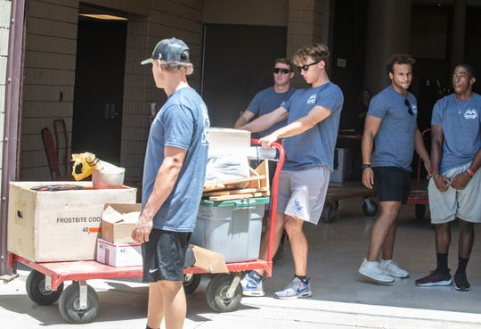 College baseball players from Auburn Montgomery help vendors bring in items during Buckmastes Expo setup day on Thursday, Aug. 15, 2019, at the Renaissance Montgomery Hotel & Spa at the Convention Center.