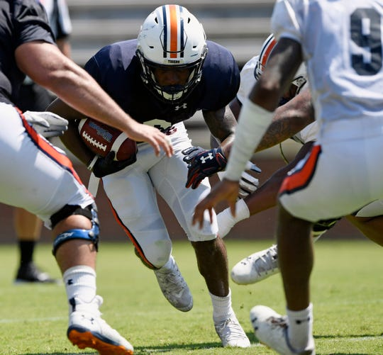 Auburn running back Kam Martin carries the ball during a scrimmage on Wednesday, Aug. 14, 2019 in Auburn, Ala.