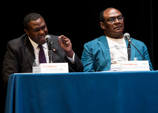 Candidate JC Love, left, during a Mayoral candidate forum at Davis Theatre in Montgomery, Ala., on Wednesday, Aug. 14, 2019.