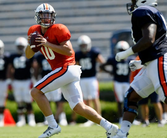 Auburn quarterback Bo Nix looks to throw during a scrimmage on Wednesday, Aug. 14, 2019 in Auburn, Ala.