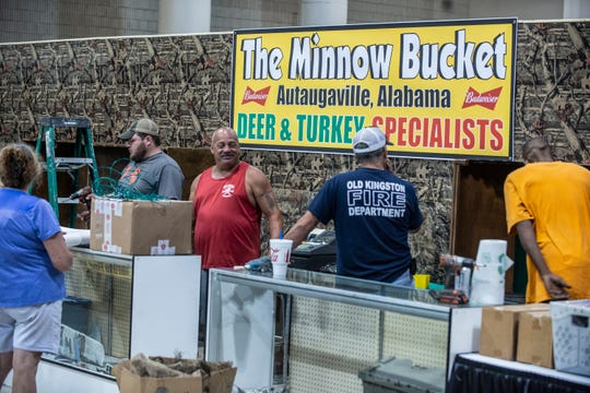 Autaugaville's own folks from The Minnow Bucket get their booths ready during Buckmastes Expo setup day on Thursday, Aug. 15, 2019, at the Renaissance Montgomery Hotel & Spa at the Convention Center.