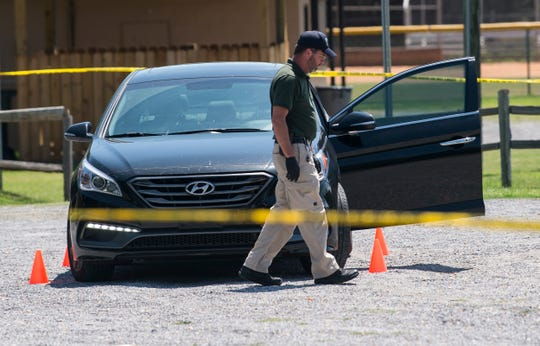 Police investigate a shooting at Newton Park in Prattville, Ala., on Thursday, Aug. 15, 2019.