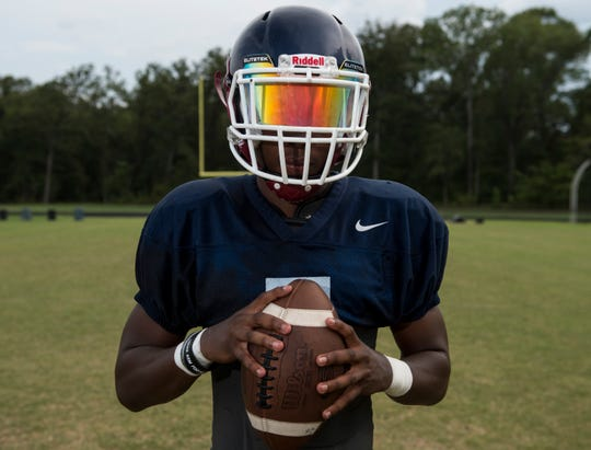 Quarterback Trevor Robinson poses for a portrait during football practice at Park Crossing High School in Montgomery, Ala., on Wednesday, Aug. 14, 2019.