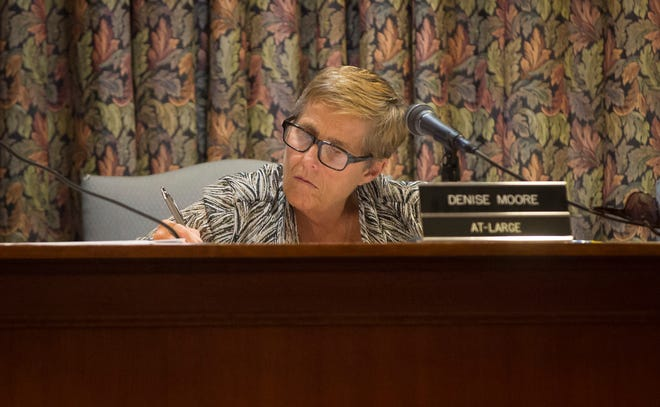 Denise Moore looks over budgets during the finance committee hearing on Aug. 14, 2019 in City Hall. Moore resigned from council the following morning due to conflict in her elected positions.