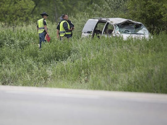 Authorities at the scene of a van crash along the Muncie Bypass on May 28, 2017. A 6-year-old girl, Taelyn Woodson, was killed when she was partially ejected from the vehicle, leading to criminal charges against her mother and that woman's boyfriend.