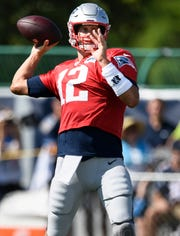 New England Patriots quarterback Tom Brady (12) throws a pass during a joint training camp practice against the Tennessee Titans at Saint Thomas Sports Park Thursday, Aug. 15, 2019 in Nashville, Tenn.