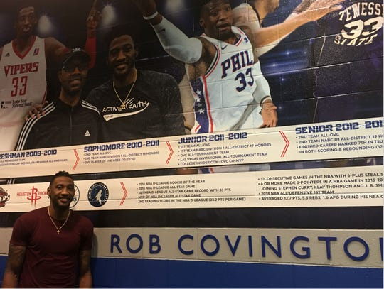 Former Tennessee State standout Rob Covington stands in front of the timeline mural on the wall in the new Rob Covington Lounge in Gentry Center.