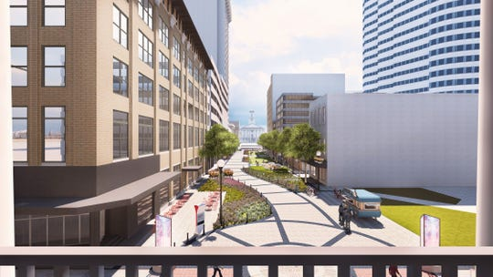 A rendering of Anne Dallas Dudley Boulevard redesigned with paved surfaces, green space, vendors and event spaces.