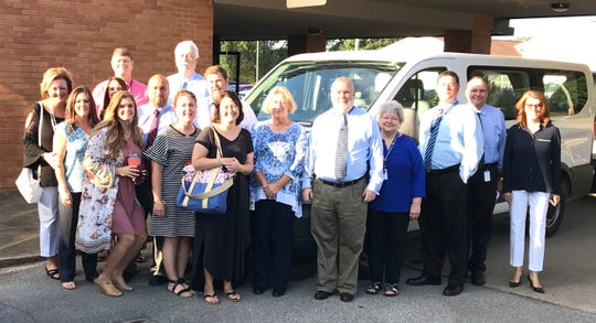 Dickson County School District administrators before boarding buses to surprise school leaders about earning Level 5 and Reward school designations.