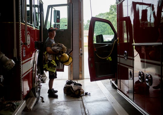Bryan Taylor, 19, puts his gear away after a night shift at the Hanover Fire Station. Taylor is paid for part time shifts but also volunteers in emergencies if he was not already working.