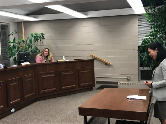 Emily Kuo, general manager of the Haworth Country Club, addresses the Haworth Borough Council at its Aug. 15 meeting as Haworth Councilwoman Heather Wasser, seated, looks on.