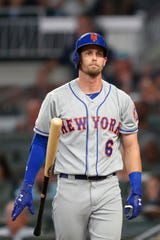 New York Mets' Jeff McNeil reacts after striking out to end the top of the fourth inning of the team's baseball game against the Atlanta Braves on Tuesday, Aug. 13, 2019, in Atlanta. The Braves won 5-3.