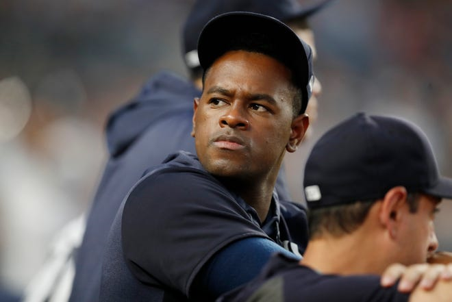 New York Yankees' pitcher Luis Severino, who is on the injured list, looks to the crowd while watching a baseball game against the Tampa Bay Rays, Tuesday, July 16, 2019, in New York.